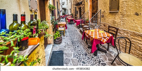 rustic tables in Castelsardo old town, Sardinia