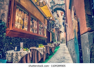 Rustic tables in a narrow alley in world famous Sorrento. Campania, Italy