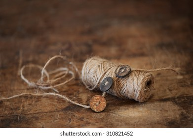 Rustic thread and wood buttons on old farmhouse table