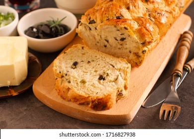 Rustic traditional olives and onion bread, close up