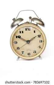 Rustic vintage desk alarm clock at the white background