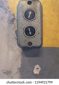 Rustic and Vintage Electrical :  Old switch on the grey and yellow cement wall in studio of building