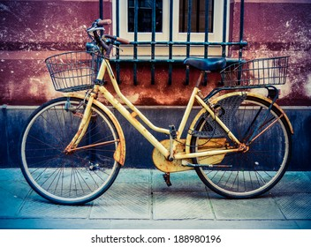 Rustic VIntage Old Bicycle On A Backstreet In Italy