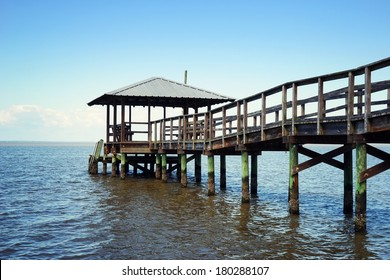 Rustic vintage wooden fishing and swimming pier off the beaten path