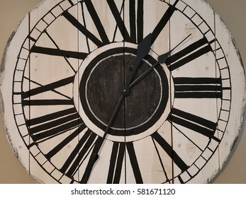 Rustic wall clock with roman numerals