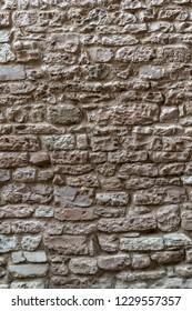 Rustic wall made of irregular stones blocks