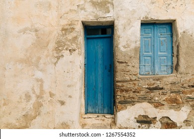 Rustic wall old paint blue door and blue window original house