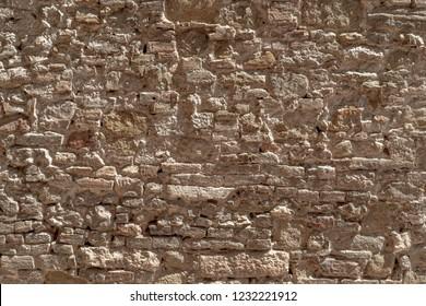 Rustic wall texture of irregular stones