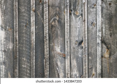 rustic, weathered board and batten wood siding