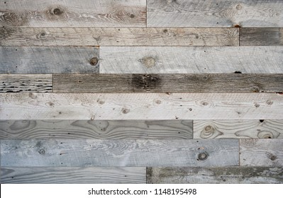 Rustic weathered wood surface with long boards lined up. Wooden planks on a wall or floor with grain and texture. Multicolor background with light pastel flat colors.