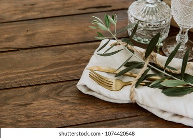 Rustic Wedding. Decorated table with vintage cutlery.