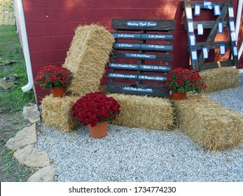 A rustic wedding with the program on wood pallet.