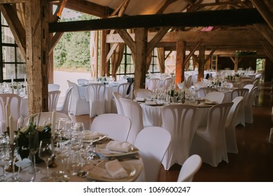 Rustic  wedding table arrangement with white napkins the hall