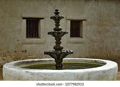 Rustic White Stone Fountain with flowing water in a Southwest Garden