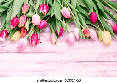 Rustic white wood background with natural style decorations spring colorful tulips. Background space for text. Natural vintage border mock up, Top view