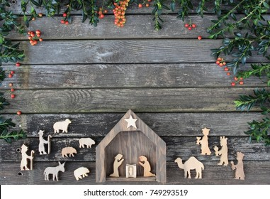 rustic wood background with christmas manger scene