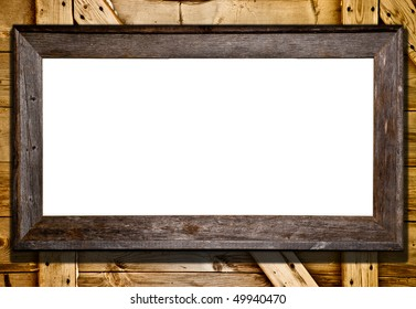 Rustic wood frame against barn door or wood panel background. Blank white template for your text or image.