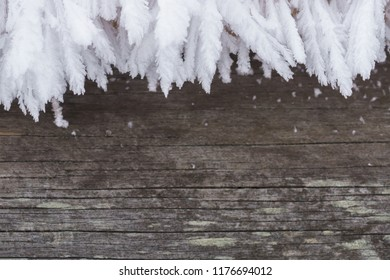 Rustic wood with hoarfrost border as cool winter background.