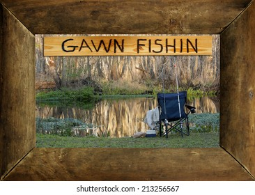 """A rustic wood picture frame surrounds a photo of the author's favorite fishing hole and an engraved wood sign that reads, """"GAWN FISHIN."""""""