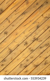 Rustic Wood Wall Vertical Texture With Tiled Wooden Decorative Planking. Vintage Exterior Or Interior Wood Slats  Shabby Background With Diagonal Boarding Or Cladding.