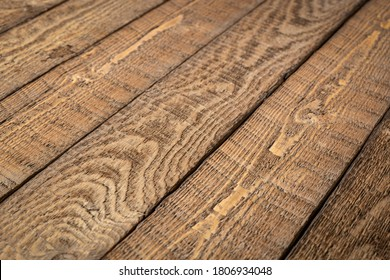 rustic wooden background - diagonal planks of weathered pine wood with strong grain, sawing  pattern and knots
