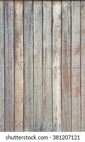Rustic wooden background made up of vertically placed beautiful aged red wood panels