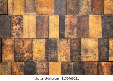 rustic wooden background - mosaic of of grunge, scratched and stained wood blcoks with a different grain pattern