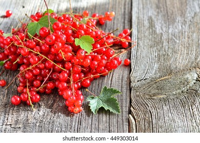 Rustic wooden background with red currants