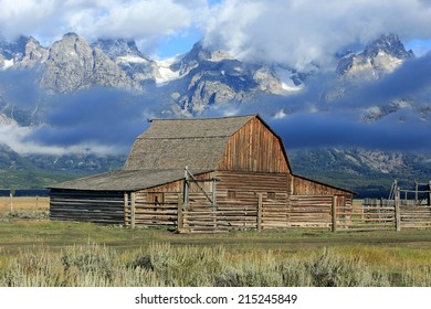 Rustic wooden barn with the Teton mountains, Wyoming, USA.