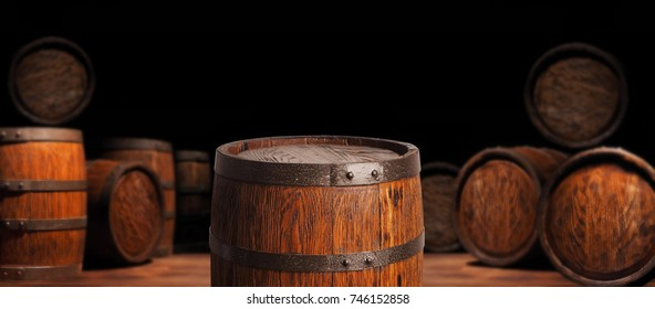Rustic wooden barrel on a night background.