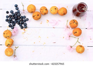 Rustic wooden breakfast background with bluberries and copy space