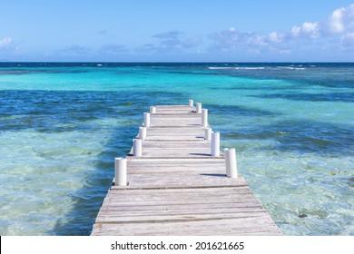 Rustic wooden dock at Playa Larga on beautiful Caribbean island of Culebra in Puerto Rico