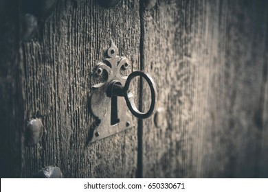 Rustic wooden door with old key