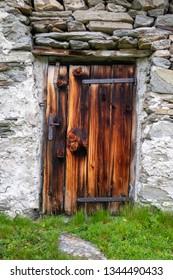 rustic wooden door on an alpine hut