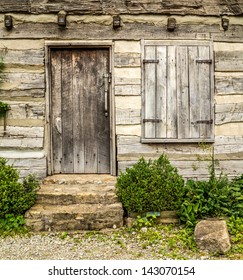 Rustic wooden door and shutters on a very old house