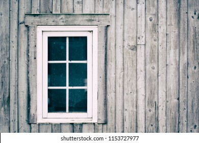 Rustic wooden exterior and window. Faded look.