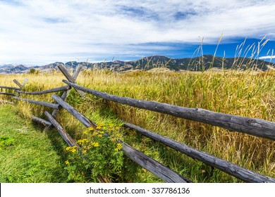 A rustic wooden fence at the edge of Cherry Creek Nature Preserve on the outskirts of Bozeman, Montana