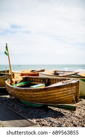 Rustic wooden fishing boat on the beach in Beer, Devon, UK