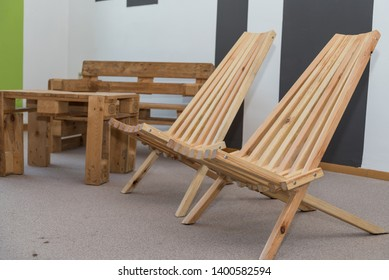 Rustic wooden furniture - table, folding chair and bench