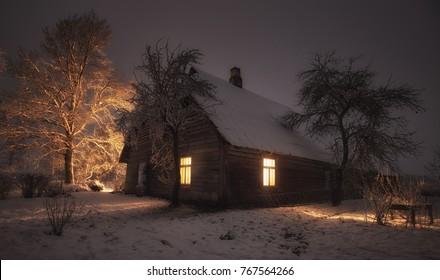 Rustic wooden house in a village. Winter in Estonia.