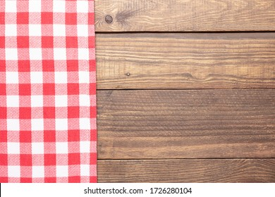 Rustic wooden and red checkeredbackground.