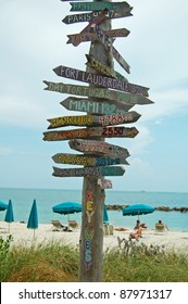 rustic wooden signpost to destinations on beach at Fort Zachary, Key West