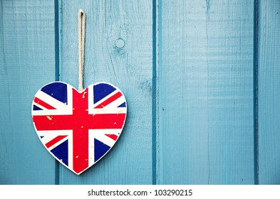 Rustic wooden Union Jack heart on blue painted wood