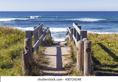 Rustic wooden walkway leading onto beach in Durban South Africa