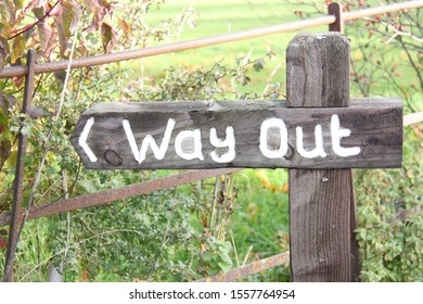 rustic wooden way out sign post in English countryside