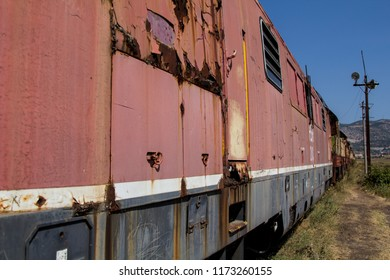 Rusting abandoned railway train on the country side in Albania
