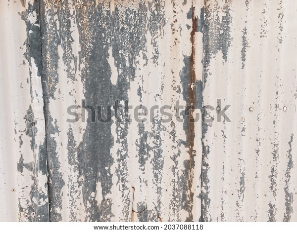 rusting faded weathered white tin metal building wall