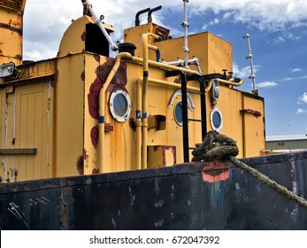 Rusting hulk moored to quay
