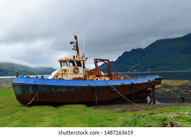 Rusting large fishing boat at side of Loch Duich, Scottish Highlands