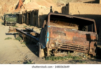 A rusting old truck is abandoned by the roadside in Yakawlang in Central Afghanistan. It was probably a Kamaz truck which are widespread in Afghanistan. The Kamaz lettering has long since been lost.